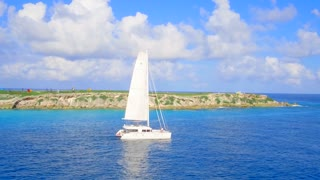 Luxury Yacht in Sail Over Tropical Blue Water by Aerial Drone