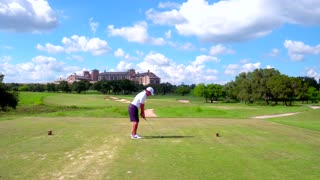 Male Teeing Off On Golf Course by Aerial Drone