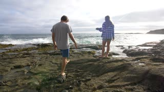 Man and Woman on the Rocks at the Beach