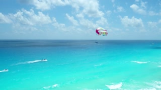 Parasailing in Blue Ocean in front of Resort Hotels