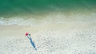 Person Walking on the Beach from Above by Aerial Drone