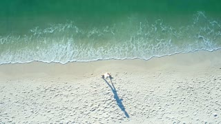 Person Walking on the Beach from Above