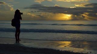 Photographer Walking On Beach at Sunset