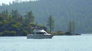 Powerboat in Emerald Bay Lake Tahoe Tracking Shot