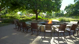 Rocking Chair Around Large Stone Fire Pit