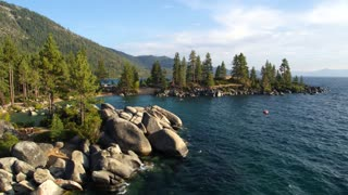 Rocks in the Blue Water of Lake Tahoe by Aerial Drone