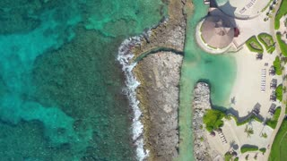 Rocks Off A Beach In the Caribbean Flyover by Aerial Drone