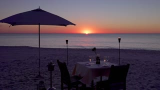 Romantic Table On the Beach Set for Two at Sunset