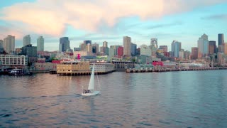 Sailboat Crosses Water by Seattle Skyline by Aerial Drone