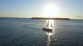 Sailboat in Front of Setting Sun
