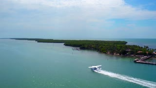 Seaplane Takes Off from Tropical Island