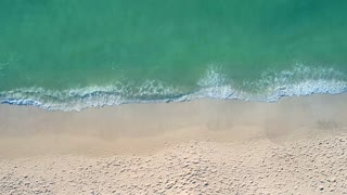 Small Waves Lapping Beach Sand