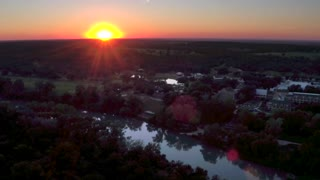 Sunset Over Green Hills and River