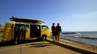 Surfers with a Classic VW Bus