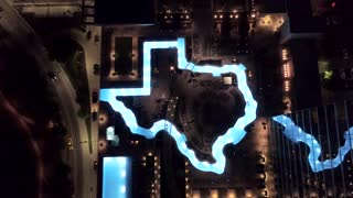 Texas Shaped Pool at Night by Aerial Drone