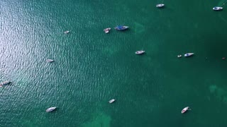 Top Down View of Sailboats Anchored Off Shore