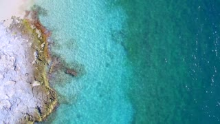 Tropical Blue Water and Dock by Aerial Drone