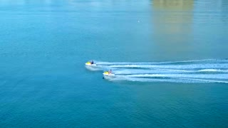 Two Jet Skis Racing Over Blue Water by Aerial Drone
