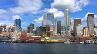 Waterfront view of Seattle skyline under blue sky
