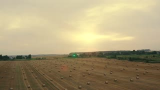 Aerial Field with Straw Bales Under Sunset Sky UltraHD