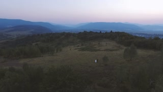 Aerial shot above Wedding Couple on Walk in the Mountains