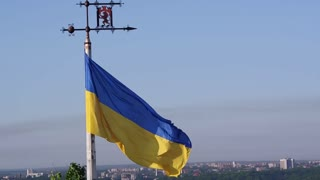 Aerial Shot Ukrainian Flag Flying on Top of the Beautiful Panorama of the City Lviv. Slow Motion 50 fps FullHD