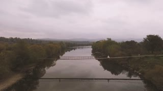 Aerial video. Loving Couple on a Wooden Bridge in the Mountains. Slow motion video