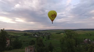 Aerial view Air balloons flying over valleys in Svirzh