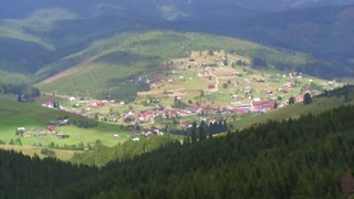 Aerial View Flight over the Mountains. Ukraine. Bukovel. Flying over the Forest