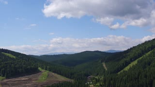 Aerial View Flight over the Mountains. Ukraine. Bukovel. Flying over the Sky