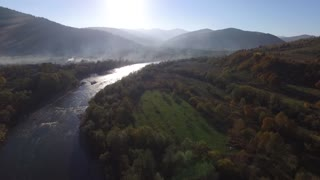 Aerial View Flight over the Mountains. Ukraine. Flying over the Sky. Forest Valley. Morning Fog. FullHD slow morion
