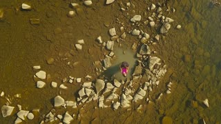 Aerial view. Loving Couple on a Mountain River