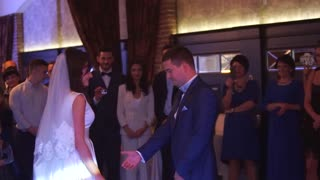 Beautiful Brunette Bride and Handsome Groom Dancing First Dance at the Wedding Party. Very Tender Moment