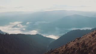 Brilliant summit dawn above flowing cloud waves in 4k