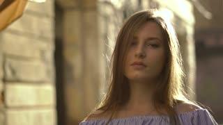 Day shot of a Beautiful Girl Walking in Town. Portrait Of Beautiful Girl