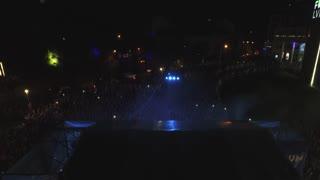 Flying over night Lviv. Concert. Many people dance. Celebrating birthday