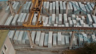 Industry Construction and Development. Workers Building a new House. Aerial Shot. The Camera Moves from the Top Down. 4k