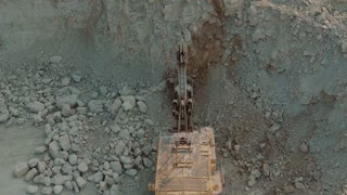 Loading the Ore Into Heavy Dump Truck at The Opencast Mining Site. Aerial Shot