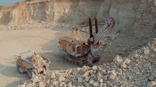 Loading the Ore Into Heavy Dump Truck at The Opencast Mining Site in 4k