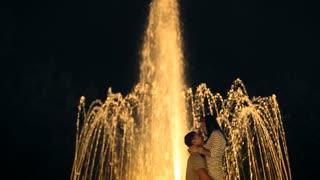 Loving Couple Kissing Near the Fountain. Italy. Arona city 20 August. Slow Motion