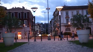People and Vehicles Passing in Time Lapse at Night in Italy City