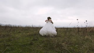 Stedicam shot. Bride from the Groom Runs. Slow motion
