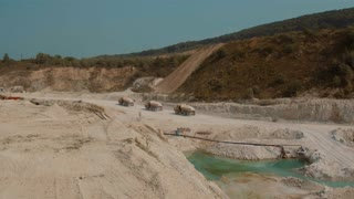 Three Large Truck Traveling on The Lime Quarry Merhelevyy. Aerial video in 4k