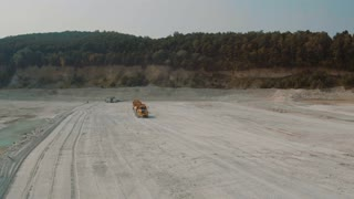 Three Large Truck Traveling on The Lime Quarry Merhelevyy. Aerial video