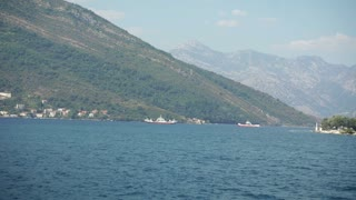 Tivat, MONTENEGRO - September 2016: Panning shot of ferry boat carrying cars and passengers from Kamenari to Tivat on September 3, 2016 in Tivat, Montenegro in 4k