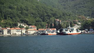 Tivat, MONTENEGRO - September 3: Panning shot of ferry boat carrying cars and passengers from Kamenari to Tivat on September 3, 2016 in Tivat, Montenegro