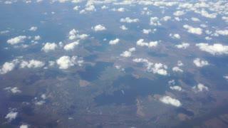 Traveling by air. View Through an Airplane Window. Montenegro. Tivat. September 4k UltraHD