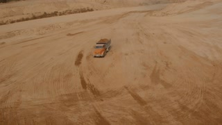 Truck loaded with sand going through the sand shaft . Aerial video in 4k