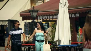 Two Young and Beautiful People Boy and Girl are Holding Hands. Italy, August 2015 in Arona