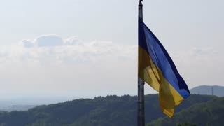 Ukrainian Flag Flying on Top of the Beautiful Panorama of the City Lviv. Aerial Shot in 4K